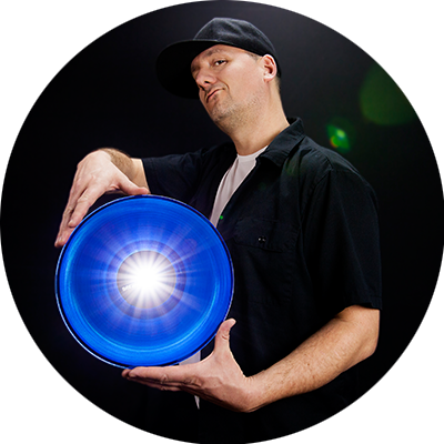 DJ Freshleecut with glowing blue vinyl record
